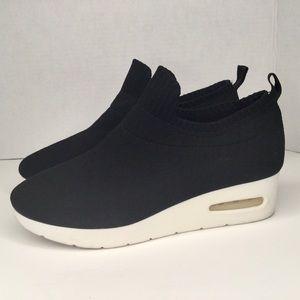 DKNY black knitted wedge sneakers.
